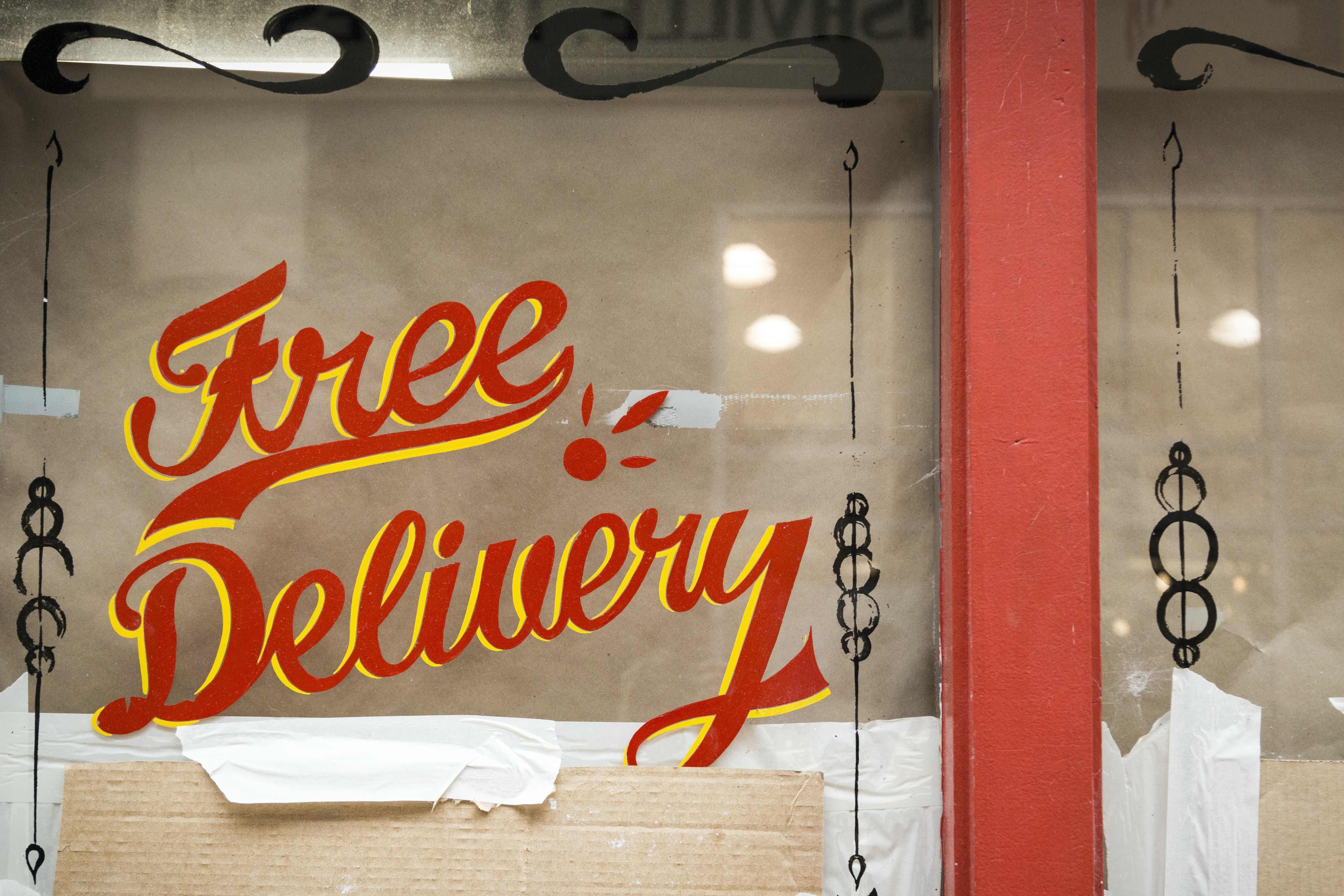 Free Delivery glass window signage